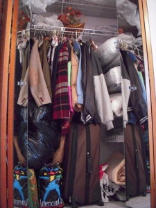 Notice the American Girl stuff, and the plaid coat that has not left this closet since we moved in.