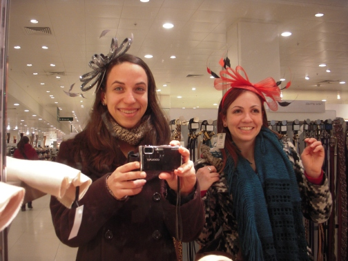 Trying on 'fascinators' at the department store.