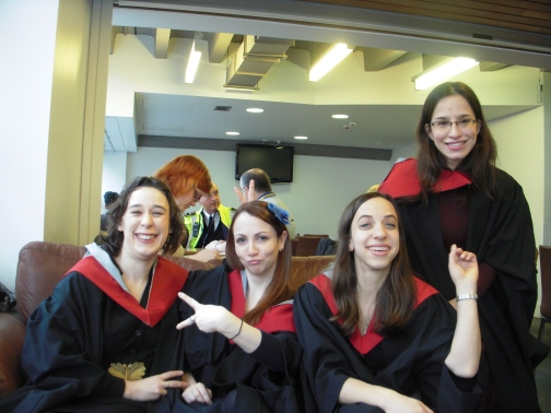 Sporting our graduation gowns in the library cafe.