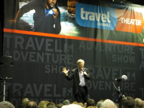 Rick Steves presenting to an attentive audience at the Travel show