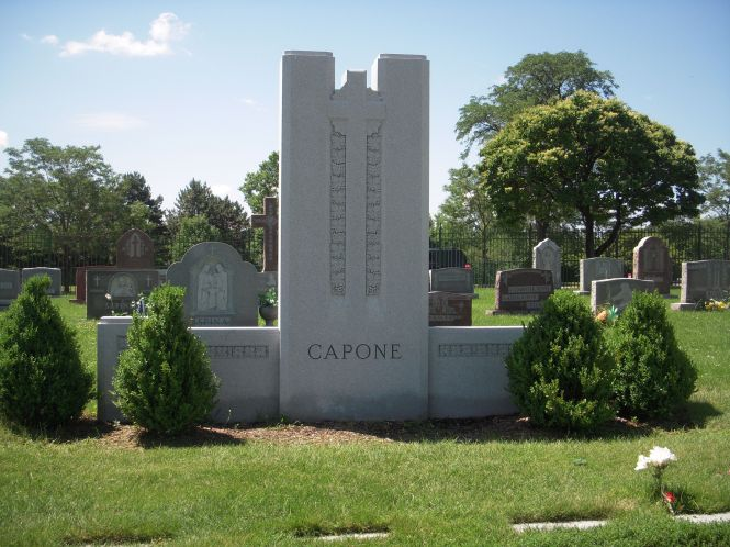 The gravesite of the Capone family; individual family markers lay in the ground before it.