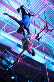 One-handed hold with my partner on the double trapeze